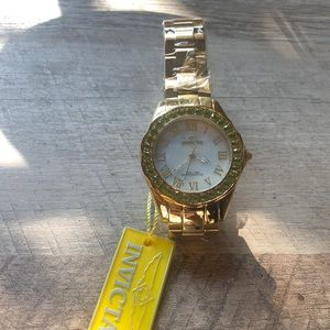 Gold watch w/ green jewels invicta never worn